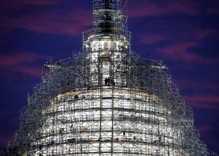 Image: Workers StandOn Scaffolding That Surrounds The Dome Of The US Capitol