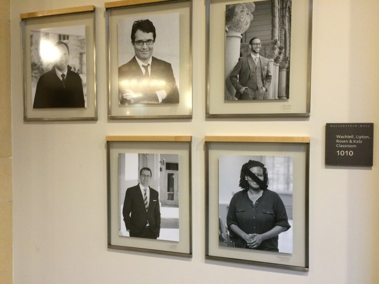 The portrait at lower right was among the portraits of black faculty members defaced with black tape at Harvard Law School.