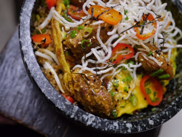 """Chinese-Peruvian chef Jesus Delgado cooks up Chinese-influenced dishes, known in Peru as a """"Chifa"""" style dish."""