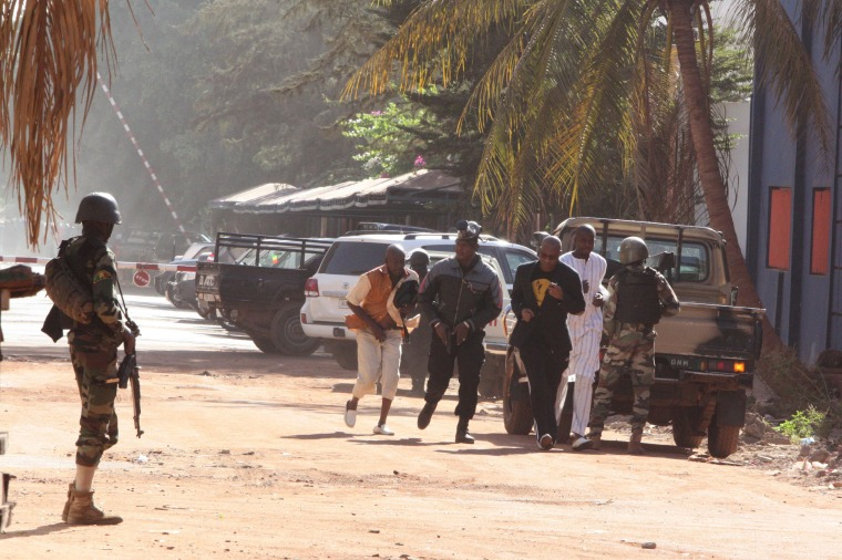 Image: People flee from the Radisson Blu Hotel