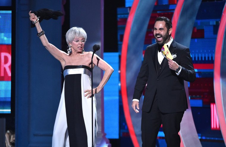 Actress Rita Moreno (L) and singer Enrique Santos speak onstage during the 16th Latin GRAMMY Awards at the MGM Grand Garden Arena on November 19, 2015 in Las Vegas, Nevada.