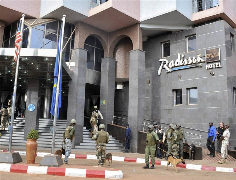 Security forces surround the Radisson Blu hotel during a hostage situation in Bamako, Mali on Nov. 20. Islamic extremists armed with guns and throwing grenades stormed the hotel in Mali's capital, killing more than two dozen people and briefly taking scores more hostage.