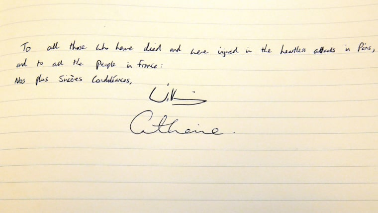 Image: Britain's Prince William, and Kate, the Duchess of Cambridge's signatures are seen in the book of condolences for the victims of the attacks in Paris, at the French Embassy, Knightsbridge, London