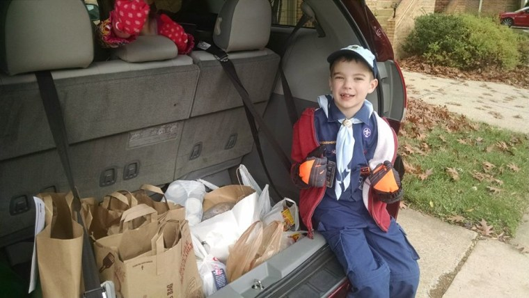 Boy with bags and bags of food he collected for a food drive.