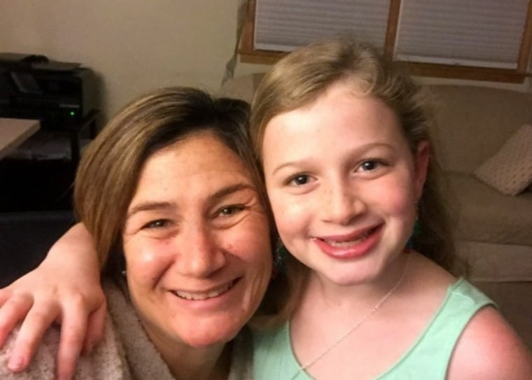A mom with her 9-year-old daughter
