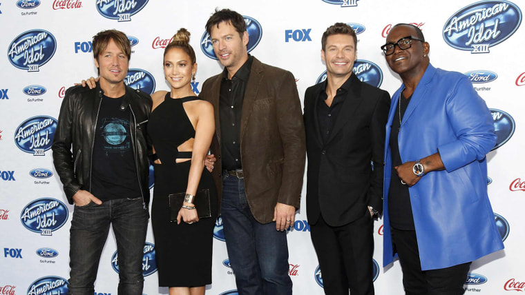 "Image: Singers and judges Urban, Lopez and Connick, Jr. pose with host Seacrest and producer Jackson at the party for the finalists of ""American Idol XIII"" in West Hollywood"