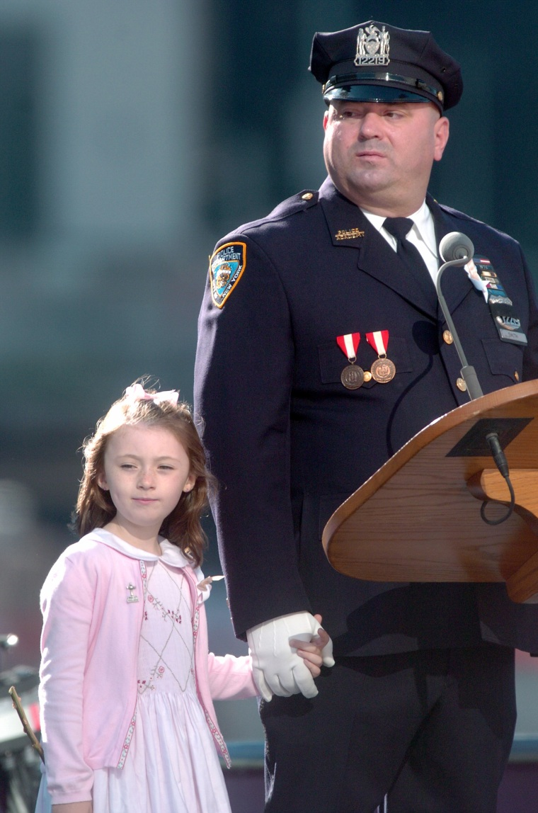 Patricia Mary Smith, 7, holds hands with her father, Office