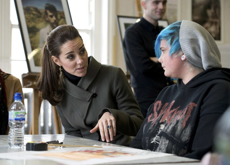 Duchess of Cambridge speaks to young people as she visits a photographic exhibition