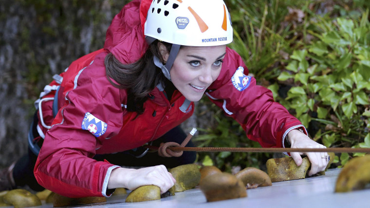 Image: Britain's Catherine, Duchess of Cambridge, ascends a climbing wall as she visits the Towers Residential Outdoor Education Centre in Capel Curig