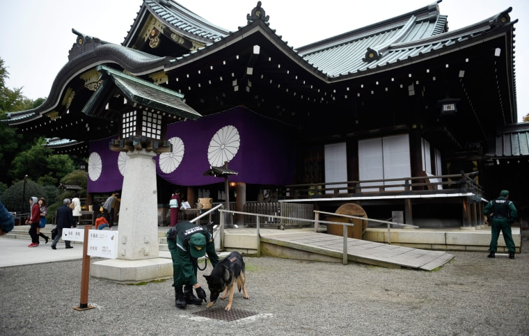 Image:  A dog squad inspects the Yasukuni shrine