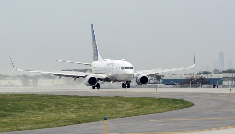 Image: A United Airlines jetliner lands on Chicago O'Hare International Airport's newest parallel runway