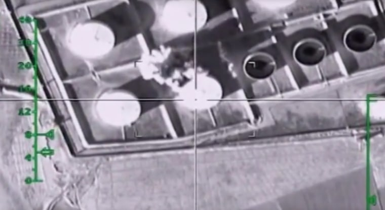 Image: Fuel tanks are hit during an attack from Russian warplanes in Syria