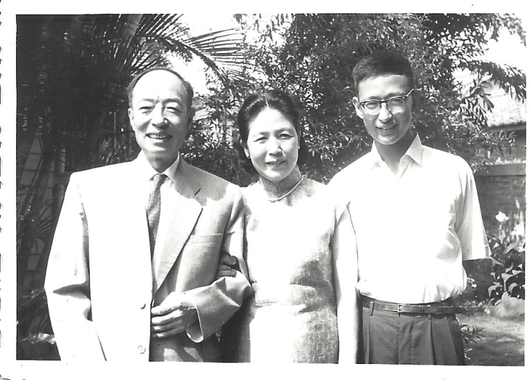 Frances Kai-Hwa Wang's father with his parents in Taiwan as he is about to leave home to start over in America as an international student with only $50 in his pocket, 1964.