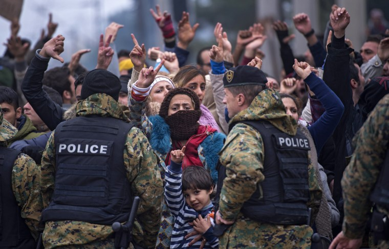 Image: Migrants who are not from Syria, Iraq or Afghanistan protest because they are not allowed to cross the border between Macedonia and Greece