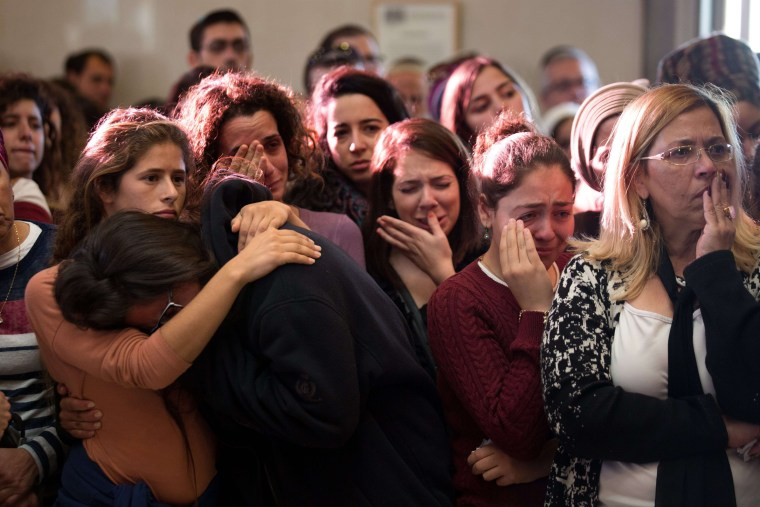 Image: Relatives and friends of Israeli Hadar Buchris mourn