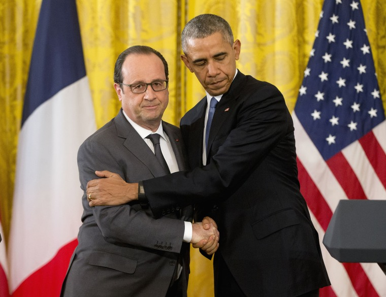 Image: Barack Obama shakes hands with French President Francois Hollande