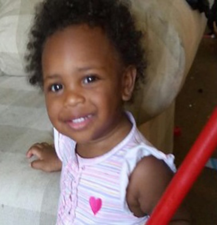 J'zyra Thompson, 19 months old, died after being burned in an oven.