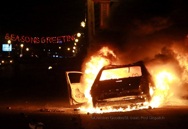 A St. Louis County Police car sits ablaze in the 300 block of South Florissant Road on Monday Nov. 24, 2014, during a night of protests in Ferguson following a grand jury decision not to indict Darren Wilson for the shooting death of unarmed teen Michael Brown in August. 