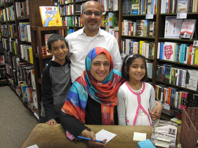 "Saadia Faruqi and her family at the launch of her book, ""Brick Walls: Tales of Hope & Courage from Pakistan."""