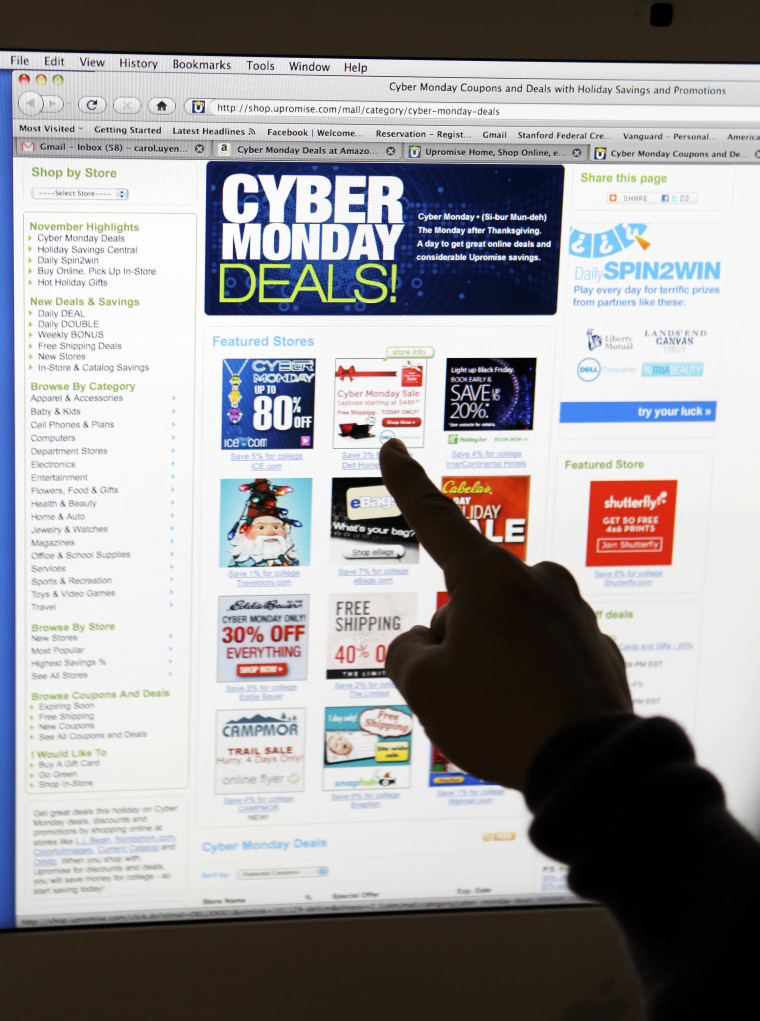 Image: A consumer looks at Cyber Monday sales on her computer