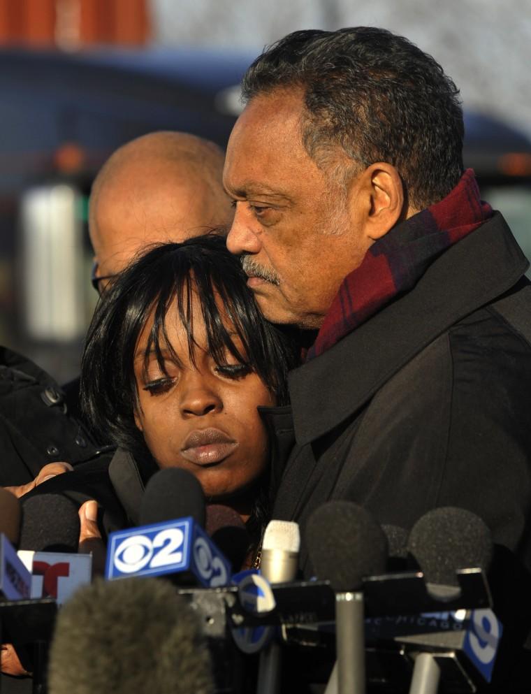 Image: Rev. Jesse Jackson, right, comforts Laquan McDonald's aunt Tanisha Hunter