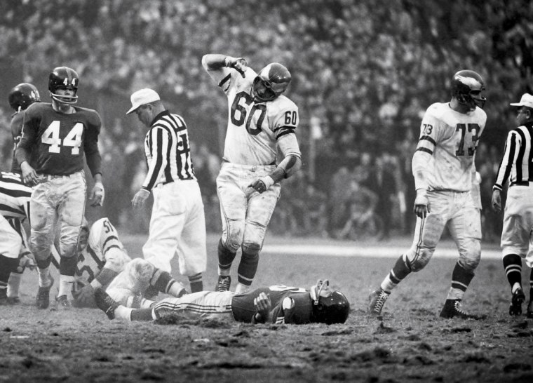 IMAGE: Chuck Bednarik tackles Frank Gifford in 1960