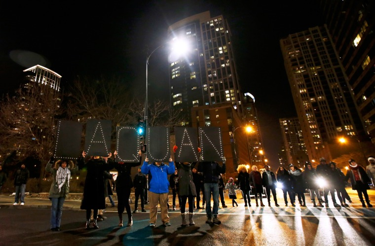 Image: Demonstrators hold signs bearing the name of Laquan McDonald during protests in Chicago