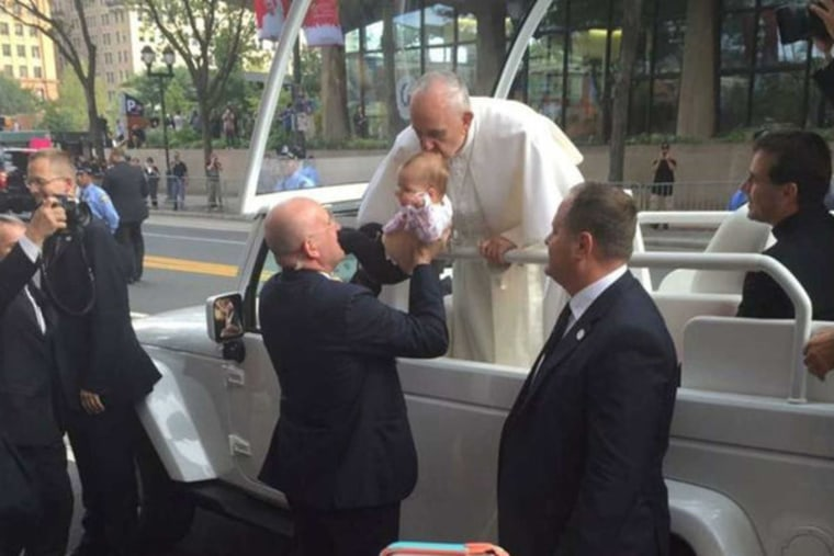 Pope Francis kisses Gianna Masciantonio on the head during his rally in downtown Philadelphia.
