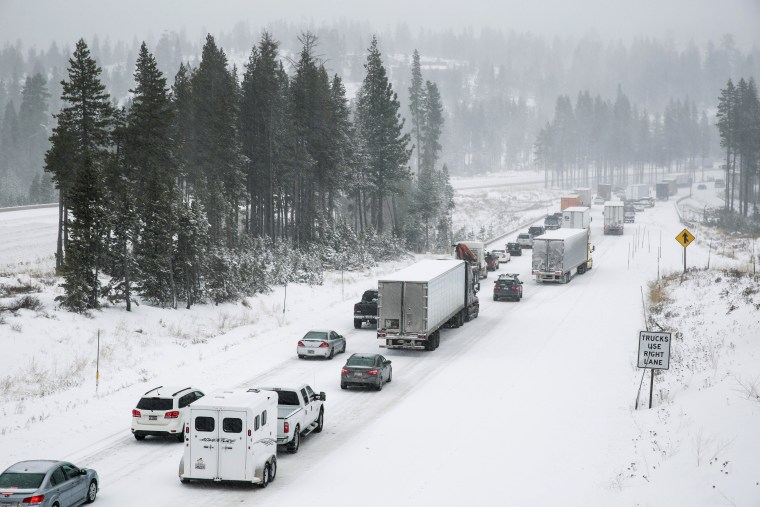Image: Eastbound traffic crawls over Donner Summit on the Interstate 80 near Soda Springs, California
