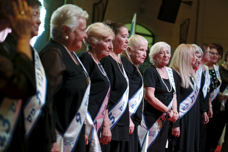 Image: Holocaust survivors stand on a stage during a beauty contest for survivors of the Nazi genocide in Haifa