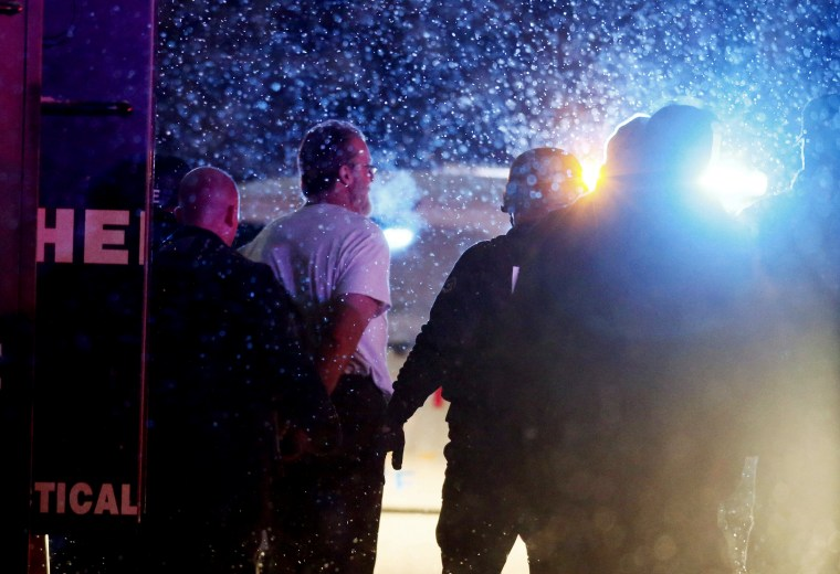 Image: A suspect is taken into custody outside a Planned Parenthood center in Colorado Springs, Colorado
