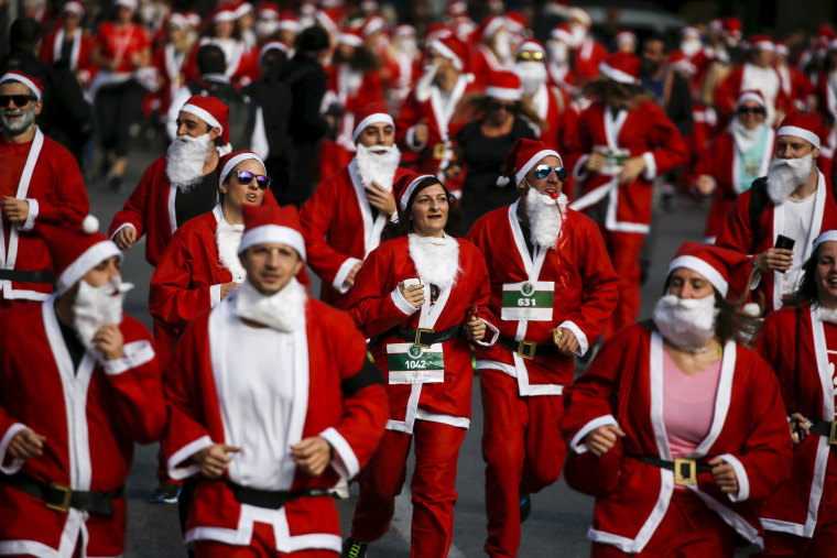 Image: People dressed in Santa costumes take part in the Santa Claus Run in Athens