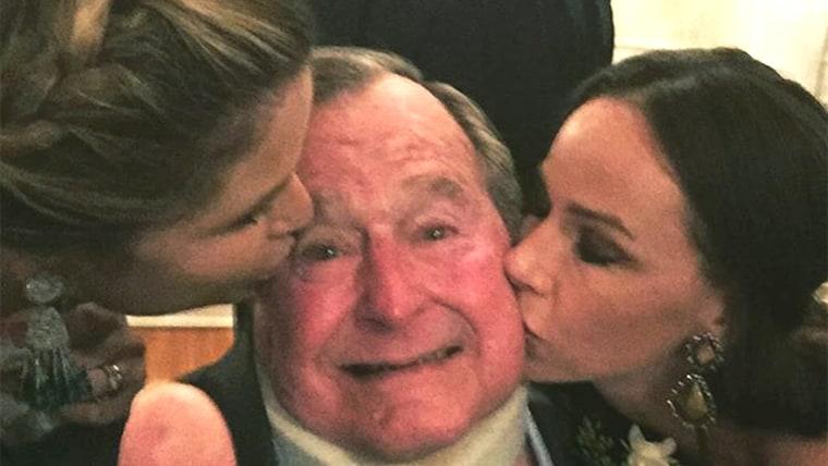 Jenna Bush Hager and twin sister Barbara give their grandpa, George H.W. Bush a kiss on the cheek