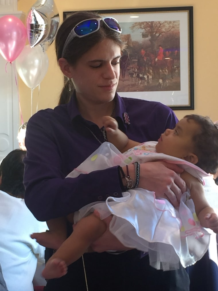 Diana Rotter holds 1-year-old Natalia, the baby who received part of her liver.