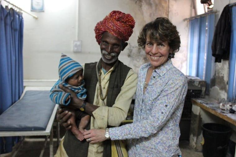 Chesca Colloredo-Mansfeld, far right, is pictured in a clinic in India with a baby who received treatment for clubfoot.