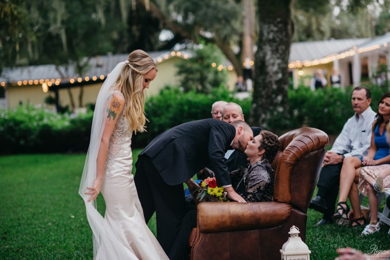 Tyler and Amanda Crosby giving Dot a hug on their wedding day.