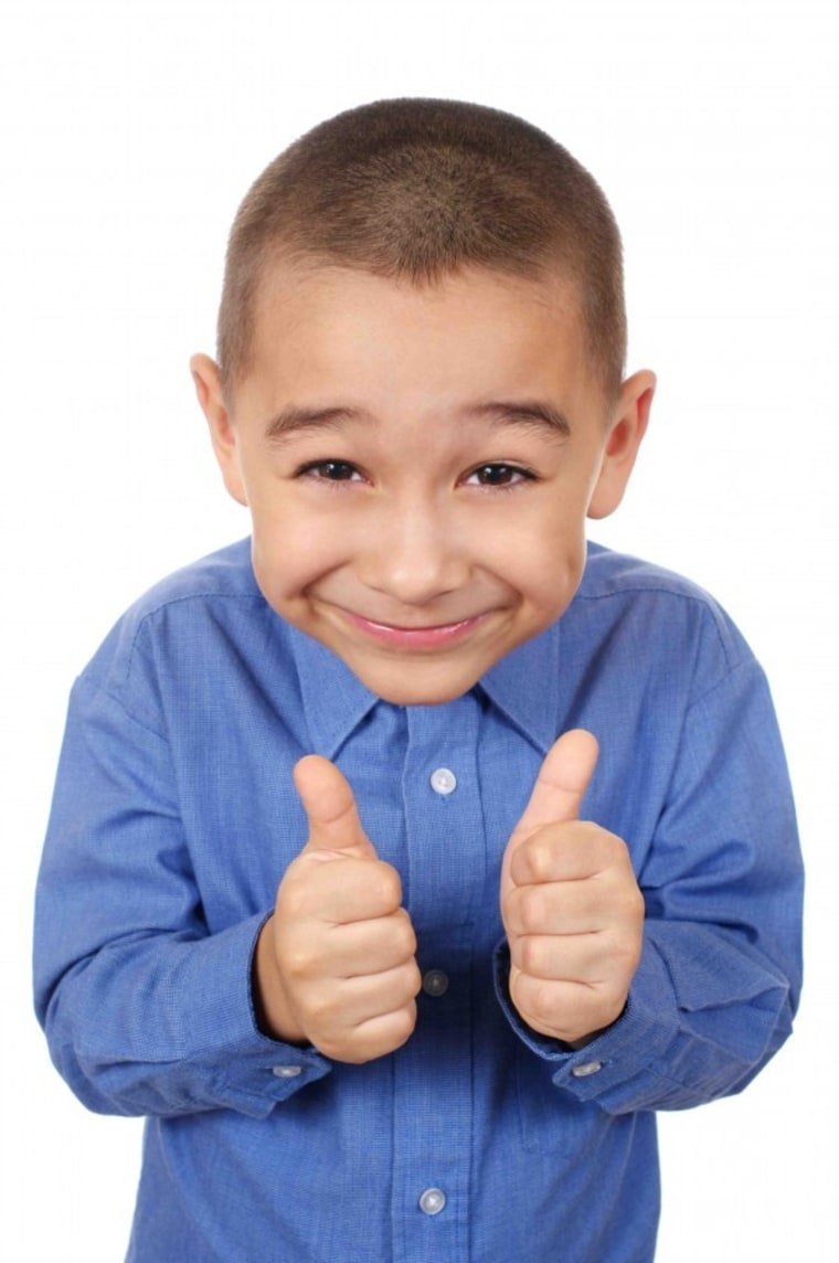 Little boy giving thumbs up