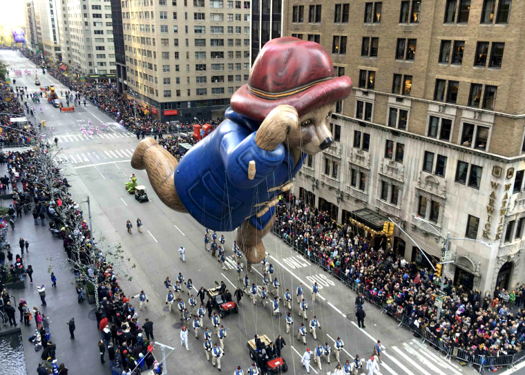 Paddington Bear proceeds high above spectators along 6th Ave during the 89th Macy's Thanksgiving Day Parade in the Manhattan borough of New York
