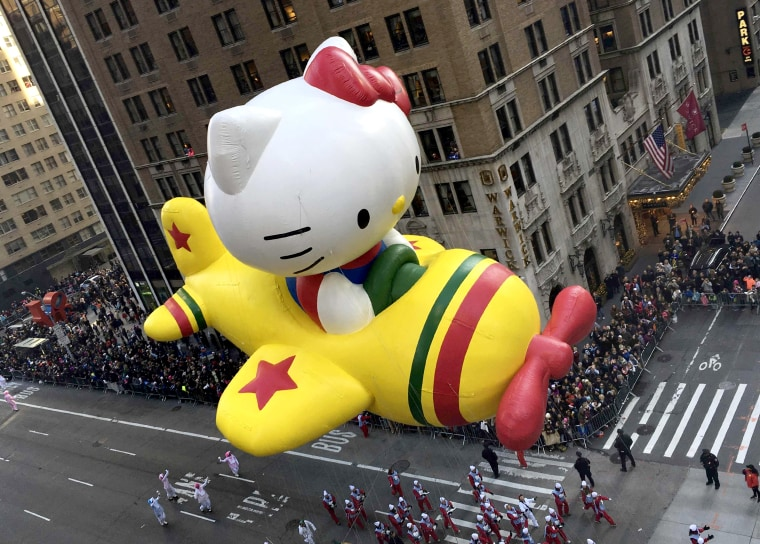 """The """"Hello Kitty"""" balloon proceeds high above spectators along 6th Ave during the 89th Macy's Thanksgiving Day Parade in the Manhattan borough of New York"""