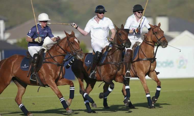 Bill Ballhaus, Prince Harry and Martin Venter in action during the Sentebale Royal Salute Polo Cup at Val de Vie Estate on November 28, 2015 in Paarl, South Africa.