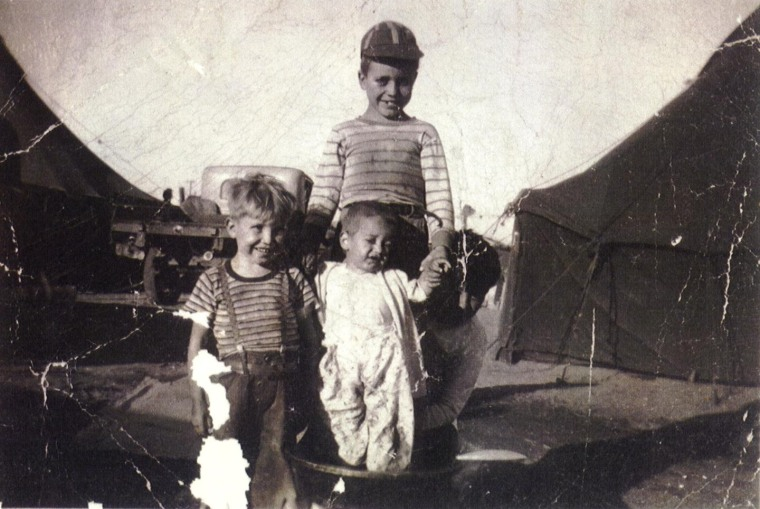 Francisco, left, and his brothers Trampita, and Roberto (wearing a cap), at Tent City in Santa Maria, Calif. Jiménez grew up in an immigrant family of farm workers.