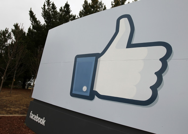 "Image: A sign with the ""like"" symbol stands in front of the Facebook headquarters"