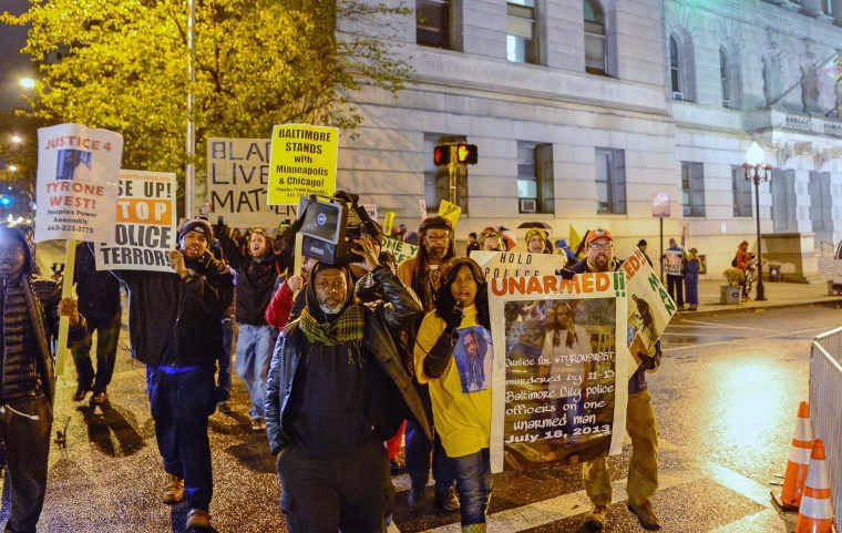 Image: Protestors march outside of the courthouse on the first day of jury selection for Baltimore Police Officer William Porter who is charged in connection with the death of Freddie Gray in Baltimore