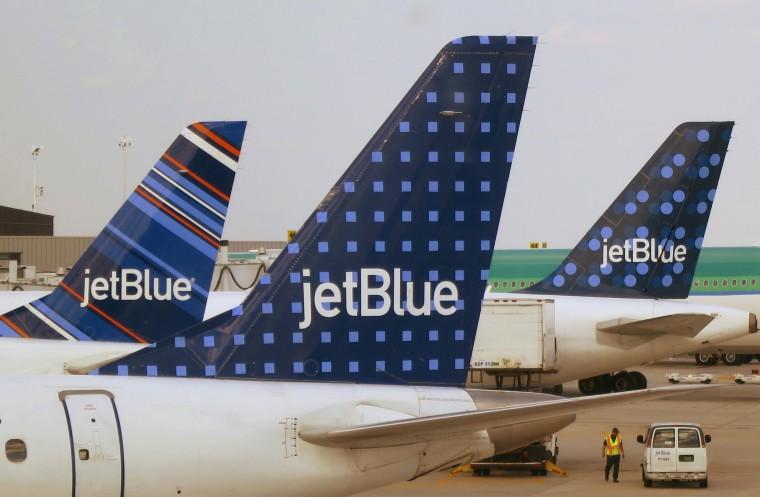 Image: JetBlue Airways aircraft wait at departure gates