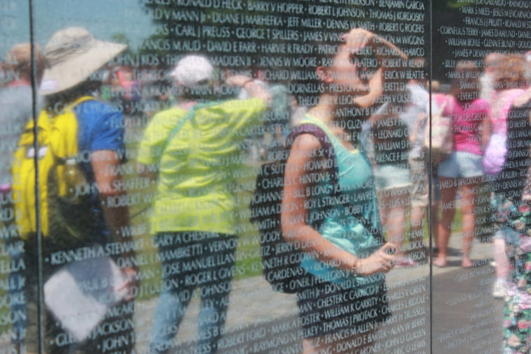 Jacqueline Mac, one of the project's narrators, observing the Vietnam Veterans Memorial in Washington, D.C.
