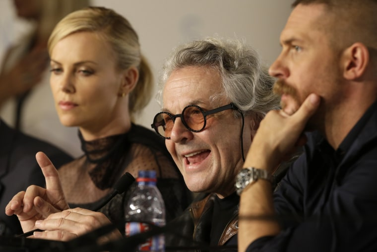 Director George Miller, center, speaks alongside Charlize Theron, left, and Tom Hardy during a press conference for the film Mad Max: Fury Road at the 68th international film festival, Cannes, southern France, Thursday, May 14, 2015.