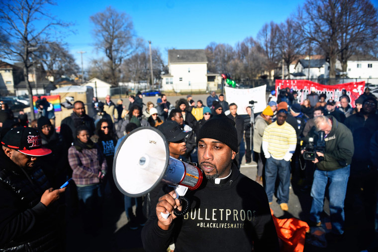 Image: Danny Givens Jr. of St. Paul, Minnesota speaks to a gathering crowd of the group Black Lives Matter before they march to city hall during a protest in Minneapolis, Minnesota