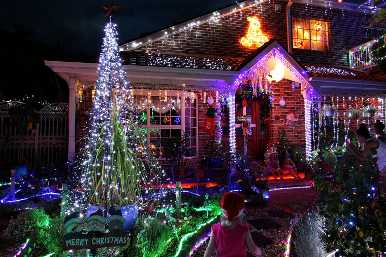 Image: Residents decorate their homes with lights