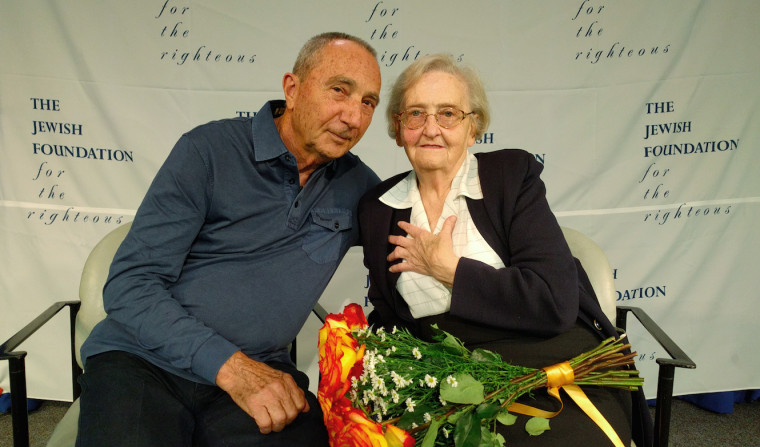 Michael Hochberg is reunited with Krystyna Jakubowska at John F. Kennedy Airport in New York. Jakubowska saved Hochberg's life during the Holocaust by pretending to be his big sister.