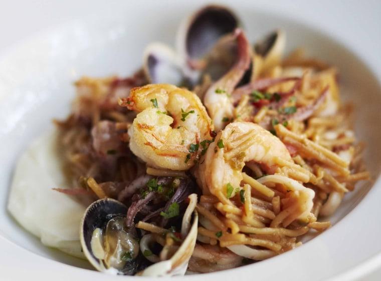 Fideuà (Valencian style noodle paella with shrimp, squid, clams) from La Vara restaurant, in Brooklyn, NY.